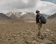 "Paul Salopek walking. Going over the Garumdee Pass (4895m). Guiding and photographing Paul Salopek while trekking with 2 donkeys across the ""Roof of the World"", through the Afghan Pamir and Hindukush mountains, into Pakistan and the Karakoram mountains of the Greater Western Himalaya."