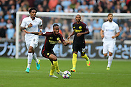 Raheem Sterling of Manchester city makes a break.Premier league match, Swansea city v Manchester city at the Liberty Stadium in Swansea, South Wales on Saturday 24th September 2016.<br /> pic by Andrew Orchard, Andrew Orchard sports photography.