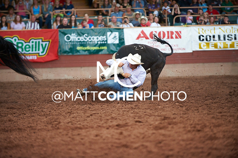 Steer wrestler Ryle Smith of Oakdale, CA competes at the Pikes Peak or Bust Rodeo in Colorado Springs, CO.<br /> <br /> <br /> UNEDITED LOW-RES PREVIEW<br /> <br /> <br /> File shown may be an unedited low resolution version used as a proof only. All prints are 100% guaranteed for quality. Sizes 8x10+ come with a version for personal social media. I am currently not selling downloads for commercial/brand use.