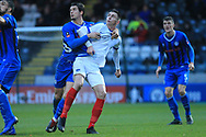 MJ Williams holds onto his opponent during the The FA Cup 2nd round match between Rochdale and Portsmouth at Spotland, Rochdale, England on 2 December 2018.