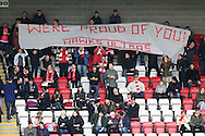 a large Banner of 'Were Proud Of You! Hawks Ultras' held up by Whitehawk FC fans during the 1st half. The Emirates FA Cup, 2nd round match, Dagenham & Redbridge v Whitehawk FC at the The London Borough of Barking & Dagenham Stadium in London on Sunday 6th December 2015.<br /> pic by John Patrick Fletcher, Andrew Orchard sports photography.