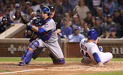 September 14, 2017 - Chicago, IL, USA - The Chicago Cubs' Anthony Rizzo (44) slides in safely at home plate to score on a sacrifice fly by Ian Happ in the fourth inning against the New York Mets at Wrigley Field in Chicago on Thursday, Sept. 14, 2017. (Credit Image: © Chris Sweda/TNS via ZUMA Wire)