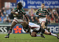 Photo: Rich Eaton.<br /> <br /> Leicester Tigers v Newcastle Falcons. Guinness Premiership. 27/01/2007. Matthew Tait of Newcastle Falcons tackles Leicester Seru Rabeni