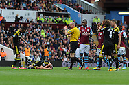 Aston Villa's Christian Benteke is sent off by ref Lee Mason for a foul on Chelsea's John Terry (on ground), deemed to be a high dangerous tackle.. Barclays Premier League, Aston Villa v Chelsea at Villa Park in Birmingham on Saturday 11th May 2013. pic by Andrew Orchard,  Andrew Orchard sports photography,