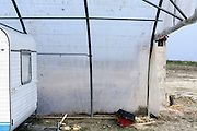 plastic greenhouse building used as garage France