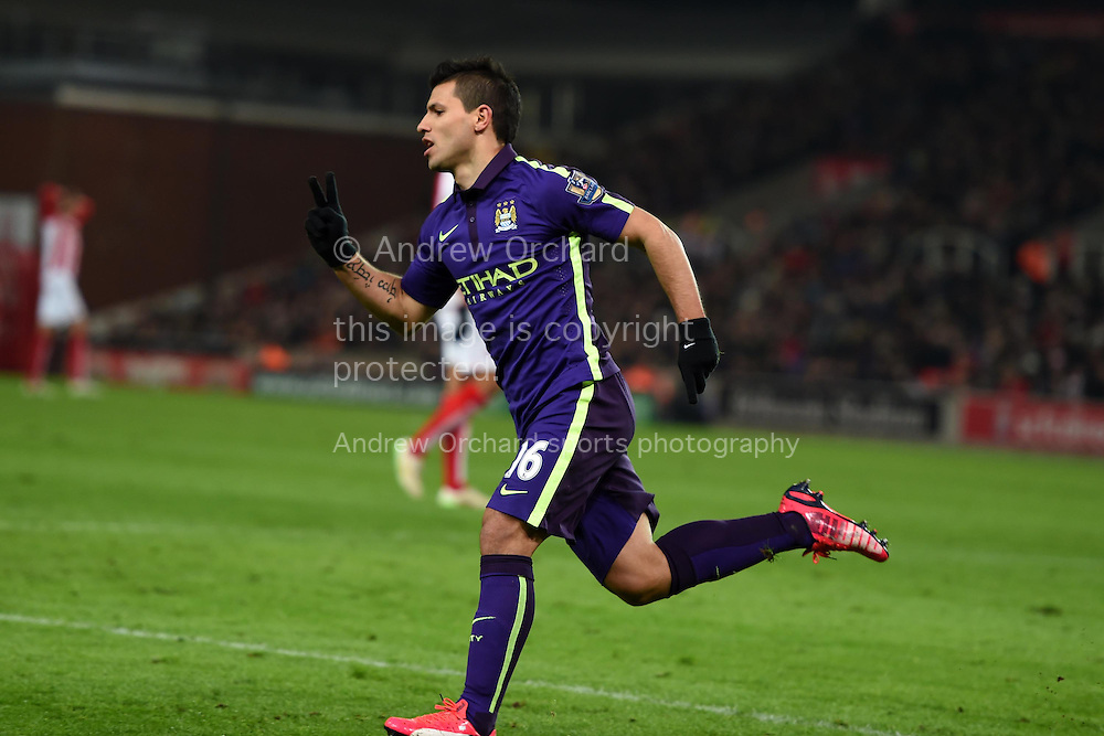 Sergio Aguero of Man city celebrates after he scores his teams 1st goal. Barclays Premier League match, Stoke city v Manchester city at the Britannia Stadium in Stoke on Trent , Staffs on Wed 11th Feb 2015.<br /> pic by Andrew Orchard, Andrew Orchard sports photography.