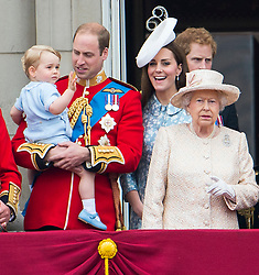 © London News Pictures. 13/06/2015. London, UK.  Prince George of Cambridge being held up by his father Prince William, joined by the Royal Family on the balcony of Buckingham Palace during the annual Trooping the Colour Ceremony in central London. The event marks the queens official birthday. .Photo credit: Ben Cawthra/LNP
