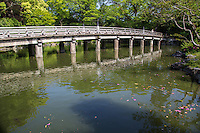 The Shusuitei bridge spans Kujo Pond and also provides a dramatic view of the southern gateway of the Kyoto Imperial Palace.