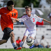 Grants Pirate Eddie Baca (3) holds off Gallup Bengal Tyler Watson (19) Thursday at Grants High School.