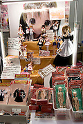 """Stall selling toys with manga characters. TOKYO COMIC MARKET """"COMIKET"""" the biggest comic market in Japan. Independent designers come to sell their comics, there is anime, manga, cosplay, toys, posters etc. At """"Tokyo Big Sight"""" exhibition center."""
