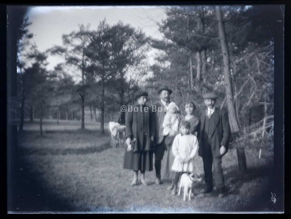blurry family portrait outdoors rural France 1921