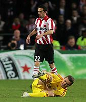 Photo: Paul Thomas.<br />PSV Eindhoven v Liverpool. UEFA Champions League, Quarter Final, 1st Leg. 03/04/2007.<br /><br />Fabio Aurelio of Liverpool grabs his leg after twisting his knee.