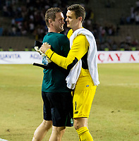 05/08/15 UEFA CHAMPIONS LEAGUE 3RD QUALIFIER 2ND LEG<br /> QARABAG FK V CELTIC<br /> TOFIQ BAHARMOV STADIUM - BAKU<br /> Celtic manager Ronny Deila (left) celebrates with Craig Gordon at full-time