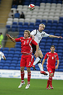 Scotland's Steven Naismith (10) wins a header from David Edwards of Wales. Wales v Scotland, friendly international football match at the Cardiff City stadium, Cardiff, Wales, UK on Sat 14th Nov 2009.  pic by Andrew Orchard, Andrew Orchard sports photography