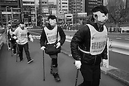 Feb. 2, 2013 - Tokyo, Japan: A group of volunteers experience what it is feels like to be disabled or handicapped, on a walking tour of the Chiyoda ward district of Tokyo. Photo by Torin Boyd.