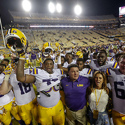 Sep 23, 2017; Baton Rouge, LA, USA; LSU Tigers head coach Ed Orgeron celebrates with his team following a win against the Syracuse Orange in a game at Tiger Stadium. LSU defeated Syracuse 35-26. Mandatory Credit: Derick E. Hingle-USA TODAY Sports