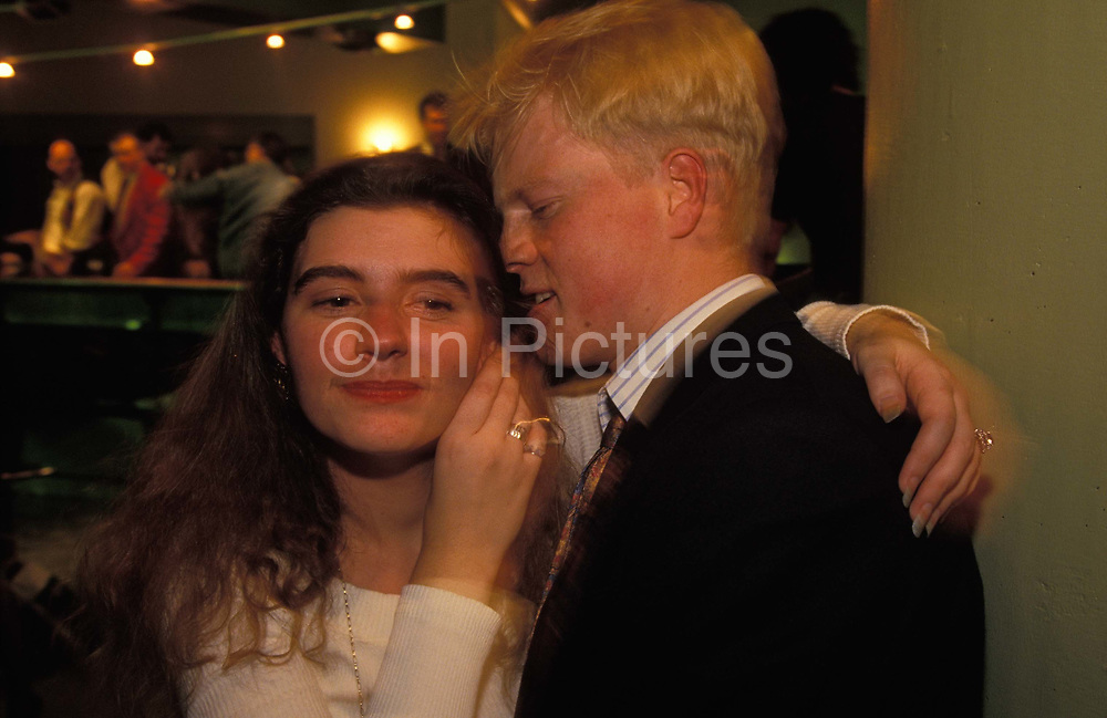 A young couple enjoy each others company during an evening at Coates Wine Bar on London Wall in the City of London, on 22nd June 1993, in London, England.
