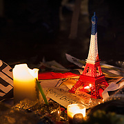 A miniature Eiffel Tower at the vigil. Londoners show their solidarity with the 12 people killed in an attack on the magazine Charlie Hebdo in Paris and their revulsion of the attack on freedom of speech at a vigil in Trafalgar Square. Three attackers killed ten journalist working for Charlie Hebdo and two police officers, the worst terrorist attack in Paris, France in 50 years.