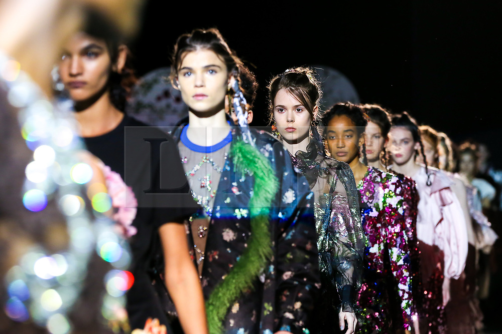 """© Licensed to London News Pictures. 21/06/2019. London, UK. Models present Preen by Thornton Bregazzi at the """"Fashion in Motion"""" at V&A Museum, wearing colourful pieces from the designers' current collection and their archive themed around floral motifs and pagan references which coincides with the Summer Solstice and its celebration of light, nature and growth. Photo credit: Dinendra Haria/LNP"""
