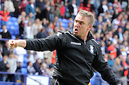Birmingham City's manager Lee Clark celebrates in front of the traveling fans after his side drew to stay in the Championship. Skybet football league championship match , Bolton Wanderers v Birmingham city at the Reebok stadium in Bolton on Saturday 3rd May 2014.<br /> pic by David Richards, Andrew Orchard sports photography.