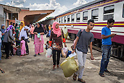 27 OCTOBER 2012 - SUNGAI KOLOK, NARATHIWAT, THAILAND:    People board a waiting northbound train in the station in Sungai Kolok, province of Narathiwat, Thailand. Sungai Kolok has been a center of extremist violence. Several car bombs have been detonated in the city, which is on the Malaysian border and very popular with Malaysian tourists. More than 5,000 people have been killed and over 9,000 hurt in more than 11,000 incidents, or about 3.5 a day, in Thailand's three southernmost provinces and four districts of Songkhla since the insurgent violence erupted in January 2004, according to Deep South Watch, an independent research organization that monitors violence in Thailand's deep south region that borders Malaysia.   PHOTO BY JACK KURTZ