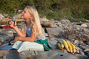 A girl and summer corn on the beach, Little Compton, Rhode Island.