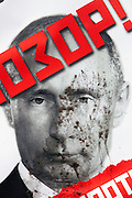 """Moscow, Russia, 13/01/2013..A mud-spattered portrait of President Vladimir Putin with the word """"Shame written across it at an opposition protest. Thousands of opposition protesters carried posters of President Vladimir Putin and members of the Russian parliament with the word ?Shame? written in red at a protest called the March Against The Scoundrels. The protest was against the new law banning the adoption of Russian children by Americans, widely seen as a response to the recently passed USA Magnitsky Act."""