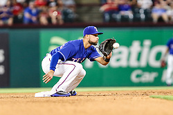 May 8, 2018 - Arlington, TX, U.S. - ARLINGTON, TX - MAY 08: Texas Rangers second baseman Isiah Kiner-Falefa (9) catches the baseball during a steal during the game between the Texas Rangers and the Detroit Tigers on May 08, 2018 at Globe Life Park in Arlington, Texas. Detroit defeats Texas 7-4. (Photo by Matthew Pearce/Icon Sportswire) (Credit Image: © Matthew Pearce/Icon SMI via ZUMA Press)