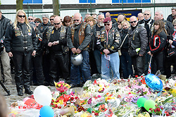 © London News Pictures. 25/05/2013. Woolwich, UK. Over A group of bikers pay their respects. 200 bikers ride to  Woolwich Barracks in South East London to pay tribute to Drummer Lee Rigby and lay flowers.  Drummer Lee Rigby was murdered by two men in Woolwich town centre in what is being described as a terrorist attack. Photo credit: Ben Cawthra/LNP