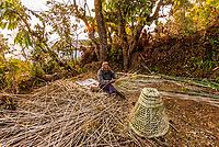 Man weaving bamboo baskets, Lekhnath, Kathmandu Valley, Nepal.