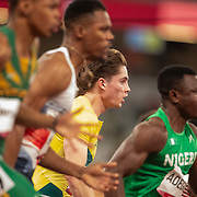 TOKYO, JAPAN August 1:   Enoch Adegoke of Nigeria and <br /> Rohan Browning of Australia in action in the 100m semi final for men during the Track and Field competition at the Olympic Stadium  at the Tokyo 2020 Summer Olympic Games on July 31, 2021 in Tokyo, Japan. (Photo by Tim Clayton/Corbis via Getty Images)