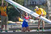 "Rio de Janeiro. BRAZIL.   PAR W1X, Gabriela MOSQUEIRA, checks her boat before the heat. 2016 Olympic Rowing Regatta. Lagoa Stadium,<br /> Copacabana,  ""Olympic Summer Games""<br /> Rodrigo de Freitas Lagoon, Lagoa. Local Time 10:26:55   Saturday  06/08/2016 <br /> <br /> [Mandatory Credit; Peter SPURRIER/Intersport Images]"
