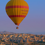 Lonely hot air balloon fly in the morning over Goreme in Cappadocia, Turkey