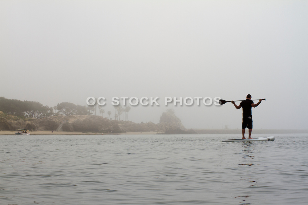 A Man and His Stand up Paddle Board  in Newport Beach Harbor