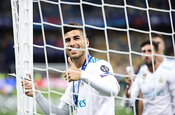 Real Madrid's Spanish midfielder Marco Asensio cuts the goal net after winning the UEFA Champions League final football match between Liverpool and Real Madrid at the Olympic Stadium in Kiev, Ukraine on May 26, 2018. - Real Madrid defeated Liverpool 3-1. Photo by Andriy Yurchak / Sportida