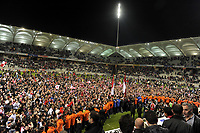 FOOTBALL - FRENCH CHAMPIONSHIP 2011/2012 - STADE DE REIMS v AS MONACO   - 07/05/2015 - PHOTO JEAN MARIE HERVIO / REGAMEDIA / DPPI - REIMS FANS CELEBRATE ON THE PITCH THE VICTORY AND THE ACCESS TO LIGUE 1 FOR NEXT SEASON