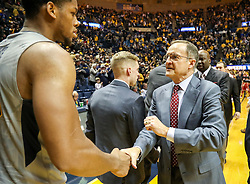 Jan 6, 2018; Morgantown, WV, USA; Oklahoma Sooners head coach Lon Kruger talks with West Virginia Mountaineers forward Sagaba Konate (50) after the game at WVU Coliseum. Mandatory Credit: Ben Queen-USA TODAY Sports
