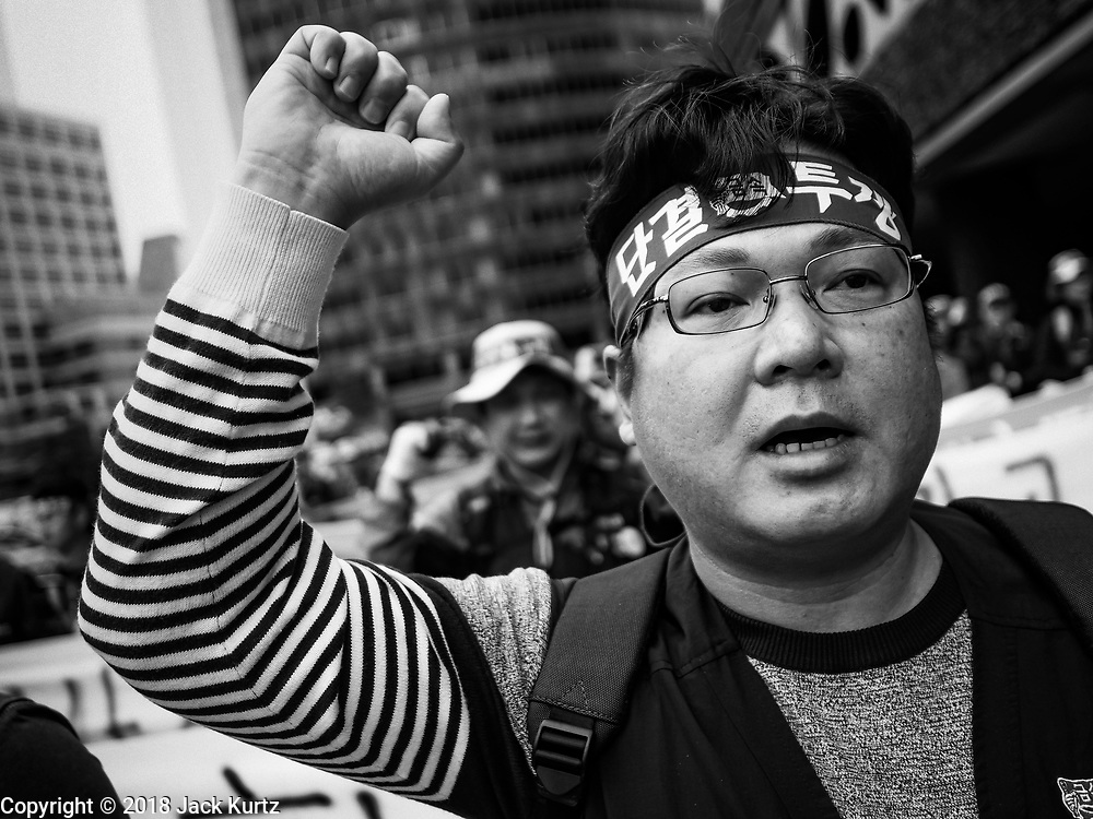 """09 OCTOBER 2018 - SEOUL, SOUTH KOREA:  Hundreds of Samsung workers marched through central Seoul Tuesday to draw attention to the company's labor issues, which includes punishing workers for joinging unions, retaliating against labor organizers and profiling potential """"troublemakers"""" who are thought likely to organize. Samsung has also started layoffing workers, especially younger ones, as company profits have decreased. Layoffs in South Korea have been relatively rare, many workers thought a job with Samsung and other South Korean industrial giants was a job for life.    PHOTO BY JACK KURTZ"""