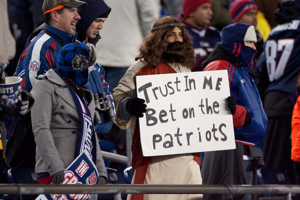 Foxborough, MA 01/14/2012.A fan dressed as Jesus cheers for the Patriots in the second half of Saturday's AFC Divisional game between the New England Patriots and the Denver Broncos..Wicked Local Photo by Alex Jones