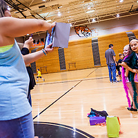 061313       Cable Hoover<br /> <br /> Dancers Mia Carabajal, right, and Jordan Chavez pose together for their parents to take photos during the Gallup High School dance camp at Gallup High School Thursday.