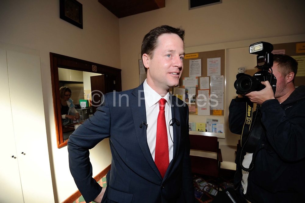 Leader of the British Liberal Democrat Party Nick Clegg is photographed by a photographer during a visit to a  church in South West London during the British Election Campaign.