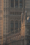 A detail of neo-Gothic architecture of the British Houses of Parliament, also known as the Palace of Westminster, the seat of the UKs government, on 17th January 2017, in London England. The Elizabeth Tower previously called the Clock Tower named in tribute to Queen Elizabeth II in her Diamond Jubilee year – was raised as a part of Charles Barrys design for a new palace, after the old Palace of Westminster was largely destroyed by fire on the night of 16 October 1834. The new Parliament was built in a Neo-gothic style. Although Barry was the chief architect of the Palace, he turned to Augustus Pugin for the design of the clock tower. It celebrated its 150th anniversary on 31 May 2009. The tower was completed in 1858 and has become one of the most prominent symbols of both London and England.