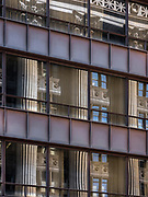 The Cook County Buildings Corinthian columns reflected in the Daley Center's windows