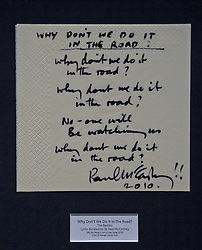 (c) London News Pictures. 06/12/2010. Pictured: A part set of handwritten lyrics for'Why Dont We Do It In The Road' by Sir Paul McCartney. Lyrics penned by famous songwriters including Sir Paul McCartney, Gary Barlow, Paul Weller and Annie Lennox go on display before the Bonhams' Entertainment Memorabilia Auction on the 15th December with proceeds going to the Teenage Cancer Trust.  Picture caption should read Will Oliver/London News Pictures.