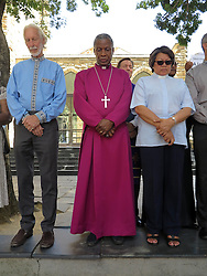 Wednesday 2nd October 2016.<br /> St. George's Cathedral,<br /> Cape Town,<br /> Western Cape,<br /> South Africa.<br /> <br /> #SaveSouthAfrica Silent Prayer Vigil In Cape Town!<br /> <br /> The Most Reverend Dr. Thabo Makgoba (centre) and other Religious Leaders stand together in silent protest on the steps of St. George's Cathedral in Cape Town.<br /> <br /> Concerned Religious Leaders and other South Africans gathered together in silent protest in support of the call to #SaveSouthAfrica from 'the acute social crisis that has been brought about by corruption, mismanagement and political intrigue' as reported nationwide in the news. The campaign was formed under the banner of holding government leaders accountable to the Constitution and the values they have pledged to uphold as representatives of the people. The #SaveSouthAfrica Silent Prayer vigil was held at St. George's Cathedral in Cape Town, South Africa on Wednesday 2nd November 2016.<br /> <br /> Picture By:  Mark Wessels / RealTime Images.