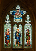 Stained glass window in Malmesbury abbey, Wiltshire, England, UK - Faith, Courage, Devotion by William Morris company c 1900