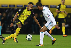 DORTMUND, Sept. 27, 2017  Pierre-Emerick Aubameyang (L) of Dortmund competes during the UEFA Champions League group H match against Real Madrid at Signal Iduna Park on Sept. 26, 2017 in Dortmund, Germany. Real Madrid won 3-1. (Credit Image: © Joachim Bywaletz/Xinhua via ZUMA Wire)