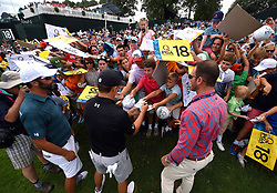 Jordan Spieth, center, stops to sign autographs for young fans along the 18th fairway following practice for the PGA Championship on Wednesday, August 9, 2017 at Quail Hollow Club in Charlotte, NC. (Photo by Jeff Siner/Charlotte Observer/TNS/Sipa USA) *** Please Use Credit from Credit Field ***