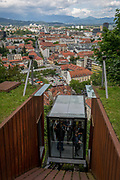 Funicular passengers arrive at the top of Ljubljana Castle in the Slovenian capital, on 27th June 2018, in Ljubljana, Slovenia.