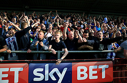 Wigan Athletic fans in the stands show their support